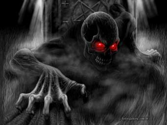 A fantastic picture of a ghoulish demon crawling from the grave.